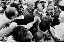 "An enthusiastic ""brotherhood"" hand clasp after the ""I HAVE A DREAM"" speech - Mahalia Jackson, Dr. Eugene Carson Blake and Walter P Reuther, UAW. Lincoln Memorial, August 28, 1963."