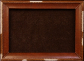 Handmade leather frame with cowhide trim. Hand stitched leather lacing, 4 inches wide, 24 x 36 in. opening, frame 32 x 44 inches. $1,450.00