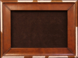 Handmade leather frame with cowhide trim. Hand stitched leather lacing, 6 inches wide, 24 x 36 in. opening, frame 36 x 48 inches. $1,800.00