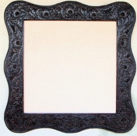 Western Dark Sienna Tooled Leather Frame, floral design with Serpentine shape, hand stitch edge lacing. Opening is 30 x 30 inches, frame size is 42.5 x 42.5 inches. $1,985.00