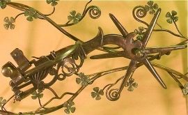 Detail of hand forged side table with Spanish spur and dogwood flowers
