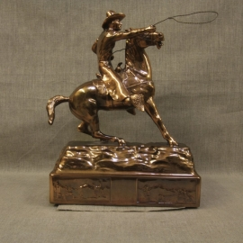 "Cowboy Throwing Lariat Copper Statue, $1,800.00. This is an extremely rare copper patina statue, it is ""mint condition, warehouse new,"" made in the 1940s by Owens Company that produced high end novelties and accessories for home and office. They produced numerous subjects, including a distinctive line of Western subjects. The Owens Company is the maker of the famous Oscars for the movie industry. I purchased the remaining warehouse inventory, which had been setting in inventory over fifty years. This is the last of a series of Western statues. I will be adding a few other different pieces over time. Inquires at Collier Gallery. Size: 13.5"" High 9.5"" Long 6"" Wide Very Heavy"